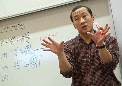 Professors in Classrooms_WMUAsianProfGesturing_6693